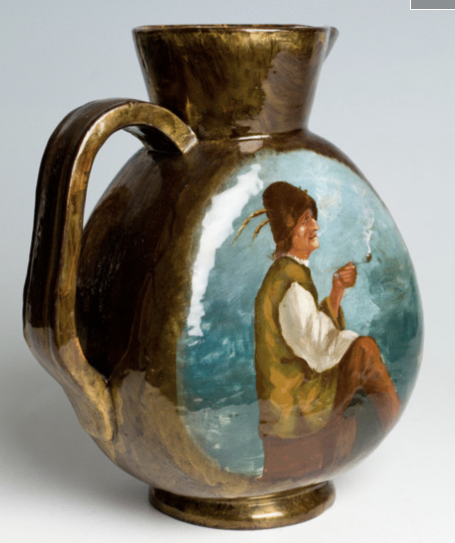 A ceramic pitcher by Emile Galle